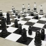 Canon and Nikon Lenses Chess Game
